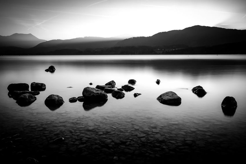 Silence Reflection Nature Lake Tranquility Silhouette Water Tranquil Scene Beauty In Nature Scenics Landscape Outdoors Floating On Water No People Mountain Reflection Lake Sky Day Mystic Mystical Atmosphere Stone Hanging Out Fujifilm Fujifilm_xseries Fuji Taking Photos