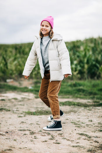Portrait of happy girl standing on land