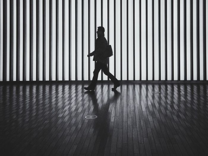 Full length of silhouette man walking in passage