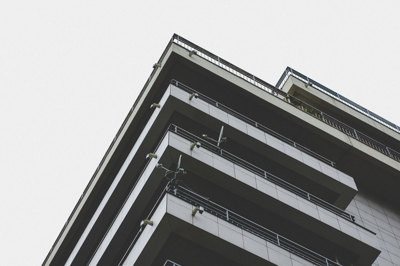 built structure, architecture, low angle view, sky, building exterior, clear sky, no people, nature, building, city, day, outdoors, copy space, modern, connection, place, residential district, industry, window, location