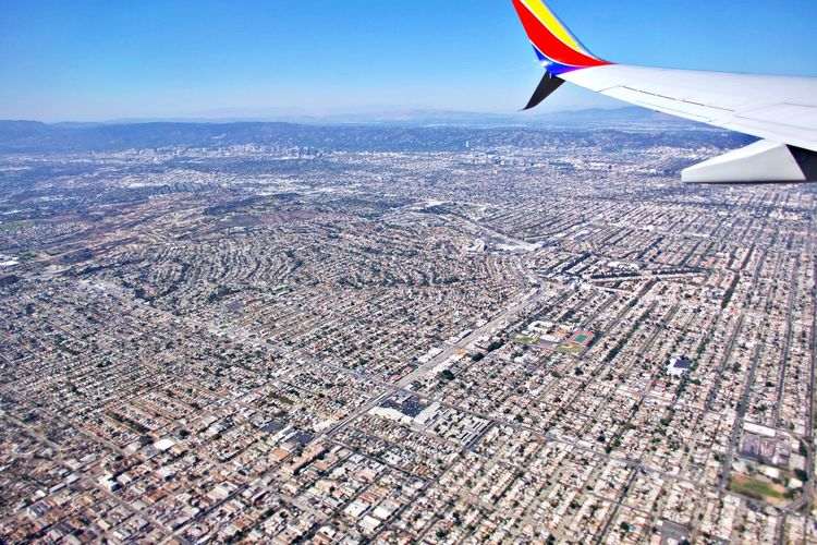 Air Vehicle Airplane Flying Transportation Aircraft Wing Mode Of Transportation Aerial View Travel Mid-air Environment No People Outdoors Journey Cityscape City