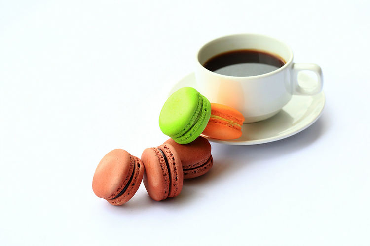 Assorted Macarons with a cup of black coffee isolated on white background. Beverage Black Branch Close-up Coffee - Drink Coffee Cup Day Delicious EyeEm Best Shots EyeEmBestPics Food Food And Drink Gourmet Green Hot Drink Macarons Meal No People Orange Porcelain  Ready-to-eat Round Studio Shot Sweet Food White Background