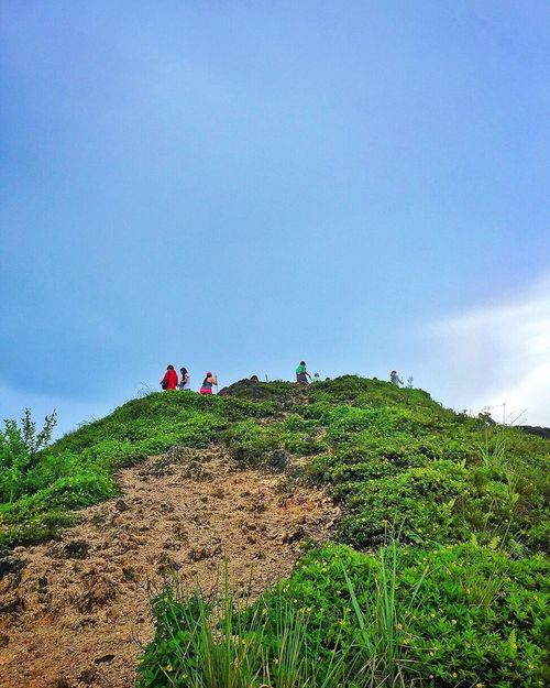 Sky Real People Day Outdoors Low Angle View Nature Mountain Adventure Grass People Tourism Travel Destinations Scenery Mountain Range Cloud - Sky Scenics Osmeña Peak Cebu City, Philippines