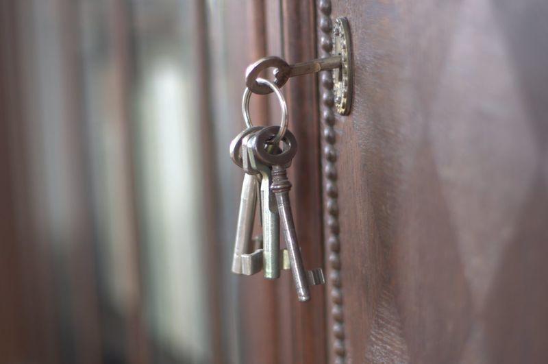 Close-up of keys hanging on door