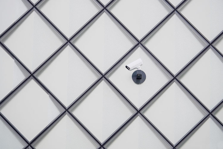 Close-up of security camera on wall