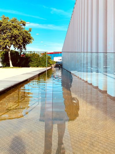 Swimming pool in city against sky