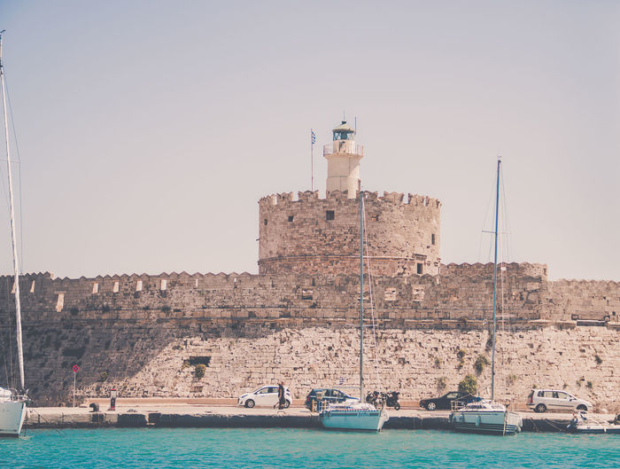 Building Exterior Built Structure Water Nautical Vessel Architecture Sky Transportation Mode Of Transportation Sea Waterfront Nature Building Day Tower Clear Sky Travel No People Travel Destinations City Outdoors Sailboat Port Passenger Craft Rhodos, Greece  EyeEm Travel Photography