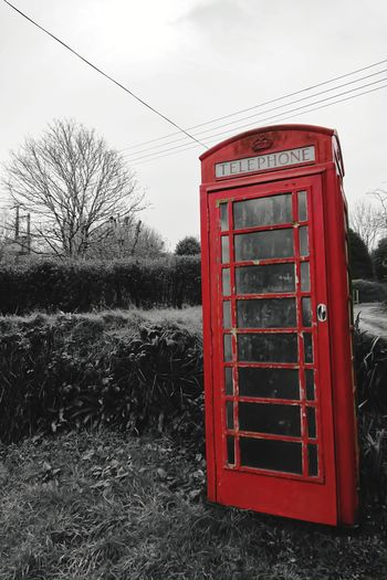 Phone Booths and powerlines Monochrome Ruralscapes Rural Scenes Rural Landscape Field Rural_living Grass Countryside Countrylife Landscape_Collection Landscape_photography Clouds And Sky Red Color Rural Scene Redphonebox Communication Telecommunications Red Redbooth Red No People Telephone Booth Outdoors Day Telephone Technology Pay Phone Sky