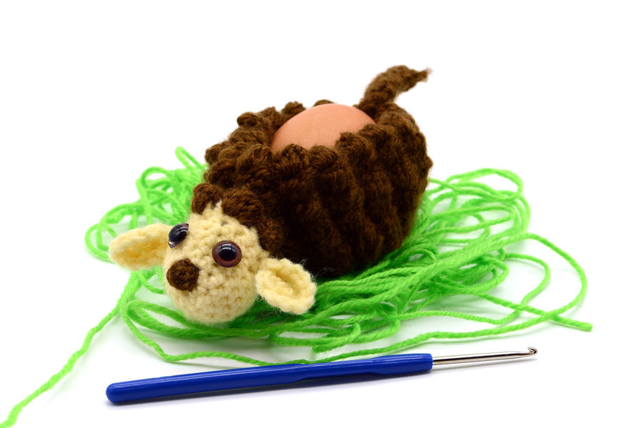 crochet brown Easter lamb egg cup made of wool with crochet hook, white isolated background Crocheting Easter Easter Egg Easter Ready Easter Eggs Egg Cups Crochet Crochet Hook Crocheted Crocheting Is My Hobby Crochetlove Easter Lamb Easter Sheeps Egg Cup Eggcup Green Color No People One Animal Sheep Studio Shot White Background