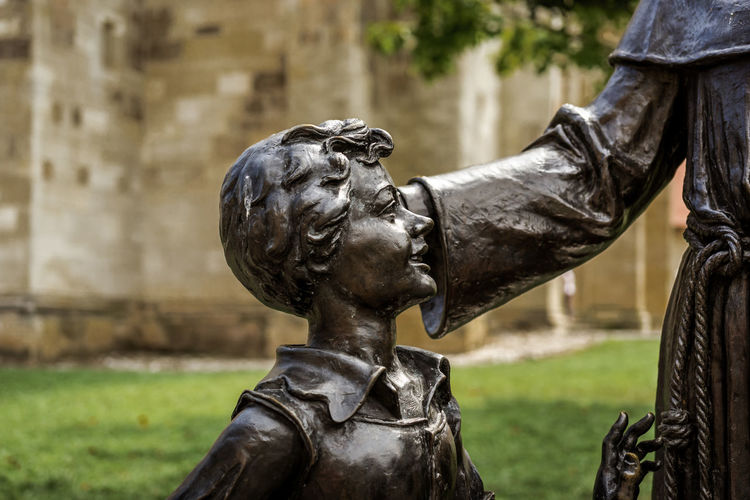Statue of a young boy Sculpture Representation Statue Art And Craft Human Representation Focus On Foreground Creativity Architecture Male Likeness History Day The Past Craft Side View No People Bronze - Alloy Close-up Outdoors Boy Child Park Summer Statue Church Religion