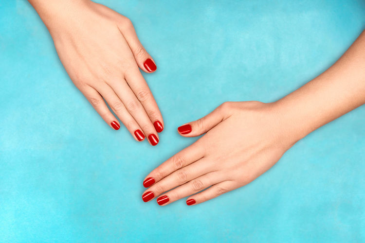 Cropped image of hands with red nail polish