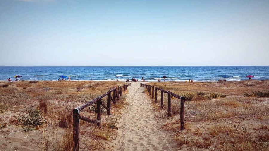 Apúlia Landscape Bestoftheday Best EyeEm Shot Best  Italy Italia Puglia Wanderlust Instatravel Travelblogger Travelphotography Travelgram Trip Picoftheday Summer Travelholic Travelers Water Sea Beach Sand Clear Sky Incidental People Sky Horizon Over Water Fence