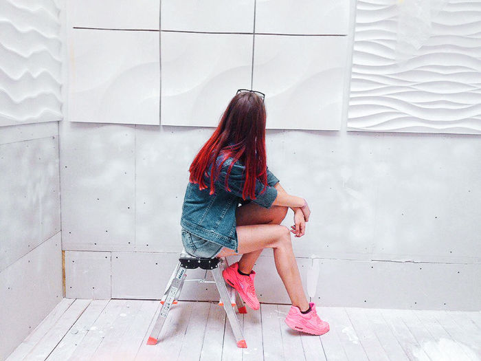 Long Hair One Person Human Hair One Young Woman Only City Young Women Day Pink White Summer Jeans Sitting Only Women One Woman Only Adult Young Adult Women Redhead People Depression - Sadness Adults Only Full Length Indoors  First Eyeem Photo