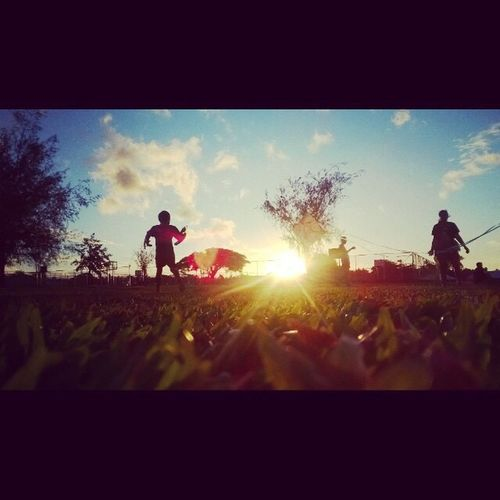 Sunlight Lens Flare Sun Sky Sunbeam Tree Real People Lifestyles Outdoors Full Length Day Leisure Activity Road Cloud - Sky Nature Scenics Chrildren Freedom Kite Flying Cheerful Childhood Beauty In Nature Paradise One Person EyeEmNewHere