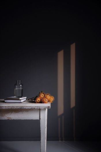 Chestnut on table against wall