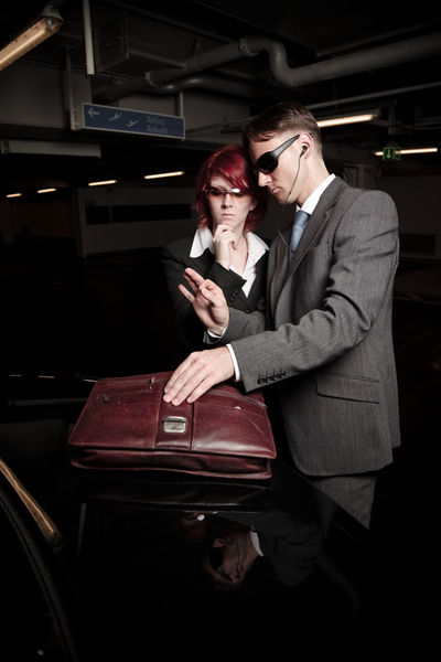 Car Park Dark Fashion Red Redhead Woman Adults Only Agent Car Car Parking Dark Indoors  Indoors  Looking Mafia  Men Night People Special Agent Suit Sunglasses Two People Well-dressed Women Young Adult