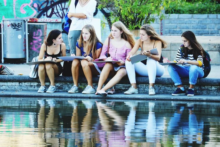 Group Of People Full Length Friendship Child Happiness Sitting Day Women Fun Girls Leisure Activity Reflection Outdoors Young Women Human Connection Exploring Fun
