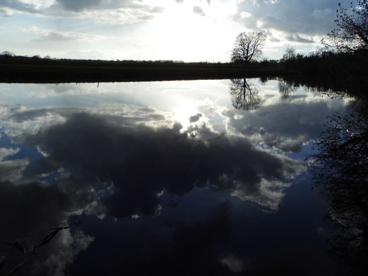 sky, cloud - sky, reflection, nature, tranquility, tranquil scene, water, silhouette, outdoors, no people, beauty in nature, scenics, day, tree