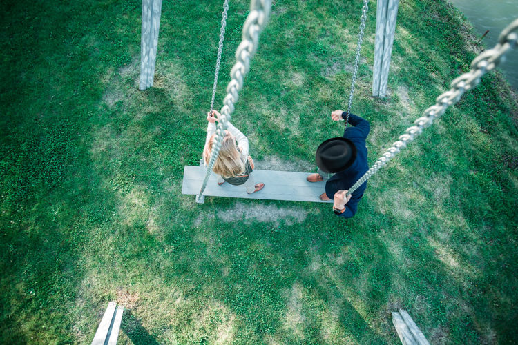 High angle view of people standing on swing