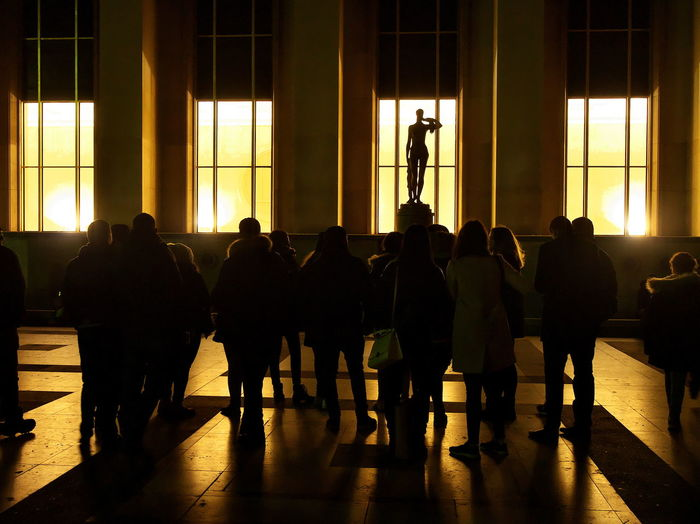 Silhouette people in corridor