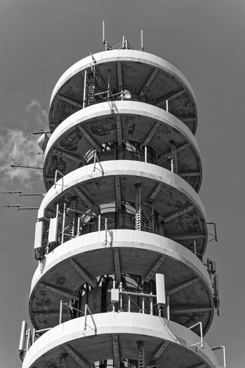 Low angle view of spiral building against sky