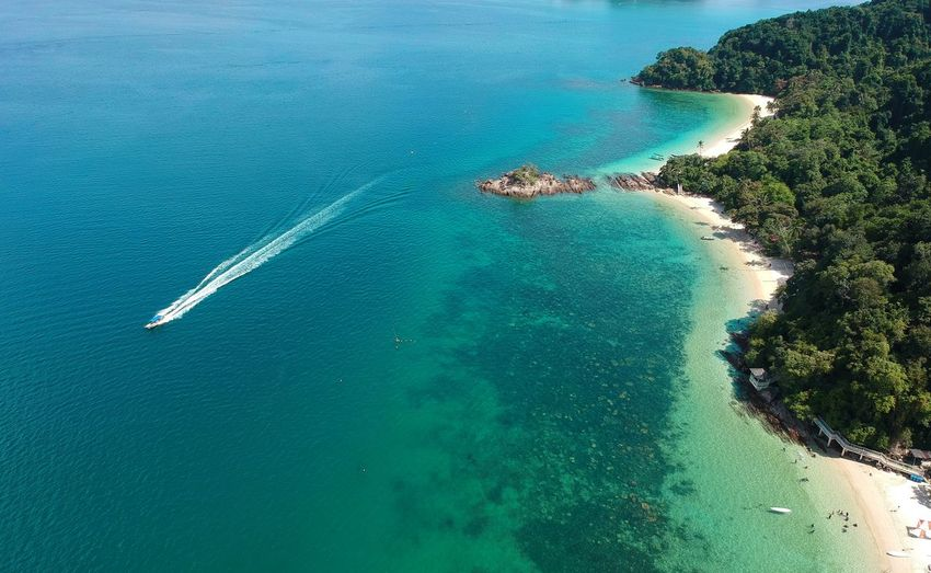 Aerial View Bay Beach Beauty In Nature Blue Day High Angle View Idyllic Land Nature No People Outdoors Plant Scenics - Nature Sea Tranquil Scene Tranquility Transportation Turquoise Colored Wake - Water Water
