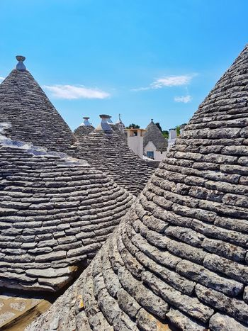 """Trulli"" houses from south Italy. Travel Destinations Ancient History Outdoors Pyramid Architecture Triangle Shape No People Built Structure Sky Day Building Exterior Ancient Civilization Italy Trulli Houses"