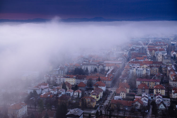 High angle view of cityscape against sky during foggy weather