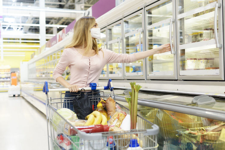 Woman having food in store