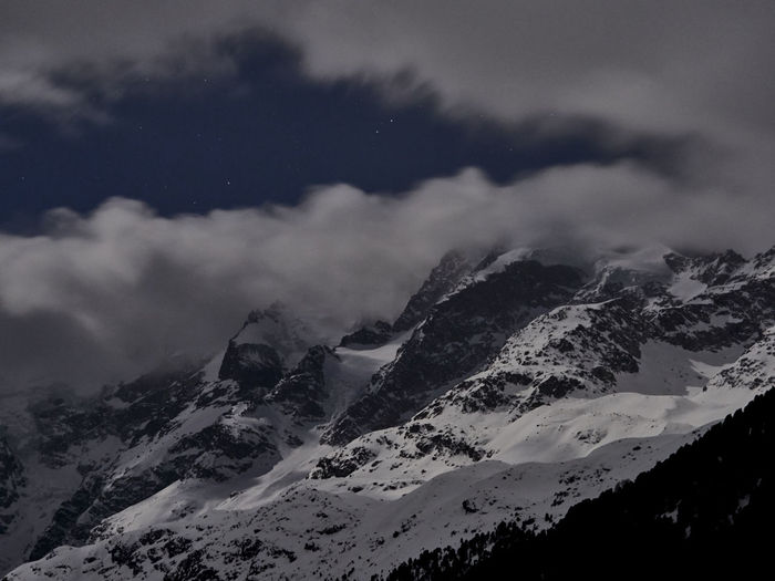 Snowcapped mountain range in the moonlight against the foggy night sky Cloud - Sky Beauty In Nature Sky Mountain Scenics - Nature Snow Winter Tranquil Scene Cold Temperature Tranquility No People Nature Mountain Range Environment Landscape Snowcapped Mountain Non-urban Scene Land Mountain Peak Night Moonlight Blue Swiss Alps Morteratsch Engadin