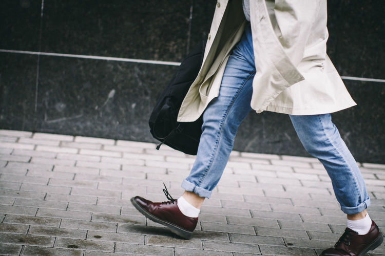Casual Clothing Coat Day Focus On Foreground Leisure Activity Lifestyles Movement Outdoors Shoes Style Stylish Walking White Socks