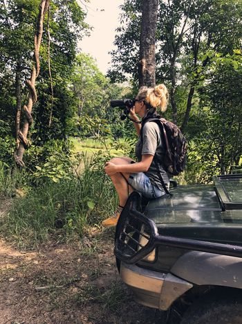 Binoculars Full Length Sitting One Person Tree Casual Clothing Young Women Leisure Activity Lifestyles Side View Forest Growth Exploring Explorer Scenics Women Jungle Jungle Life Nature Car Jeep Adventure Safari Adventure Safari Jeep Life