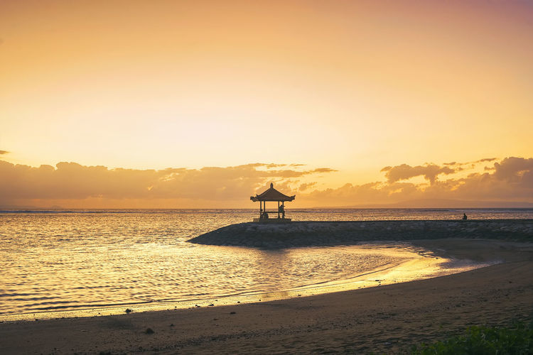 Karang beach Sanur, Bali, Indonesia in the morning ASIA Bali EyeEmNewHere INDONESIA Pagoda Beach Beauty In Nature Day Horizon Over Water Lifeguard Hut Nature Outdoors Sand Sanur Beach Scenics Sea Silhouette Sky Sunset Tranquil Scene Tranquility Travel Destinations Vacation Vacations Water