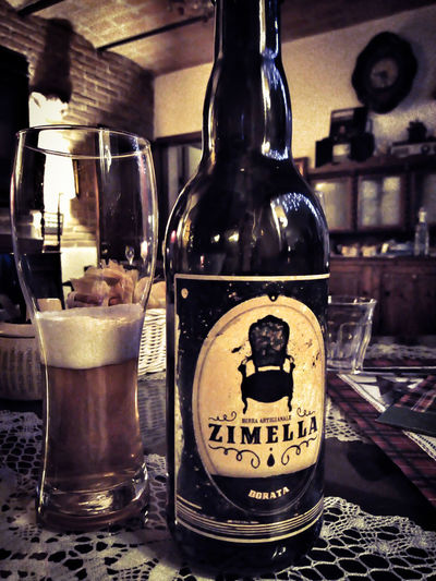 Pay attention please... Zimella, not zitella ! ;-) Food And Drink Refreshment Drink Bottle Indoors  Container Alcohol Table Still Life Close-up Glass Transparent Text No People Glass - Material Bar - Drink Establishment Freshness Western Script Focus On Foreground Business Bar Counter Zimella Beer