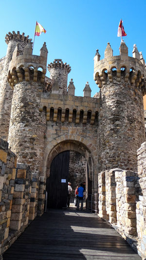 ezefer Arch Architecture Blue Building Exterior Built Structure Camino De Santiago Castle Clear Sky Day Entrance Façade Famous Place Flag Footpath Fort Historic History Medieval Outdoors People And Places Person Ponferrada Steps Sunny The Past