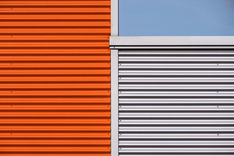 Close-up of colorful corrugates iron against clear sky