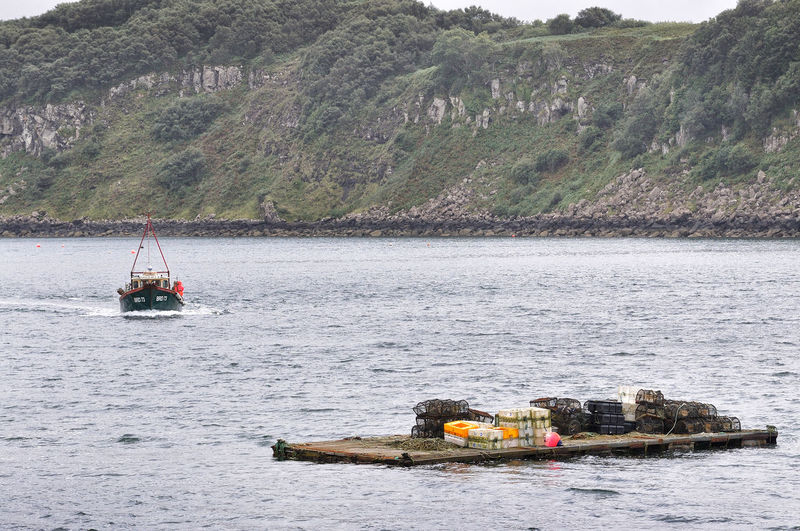 Picking up the pots - Portree Harbour, Isle of Skye Scotland Skye Day Fishing Boat Fishing Industry Fishing Pots Floating On Water Highlands Highlands Of Scotland Isle Of Skye Mode Of Transportation Nautical Vessel Outdoors Transportation Water