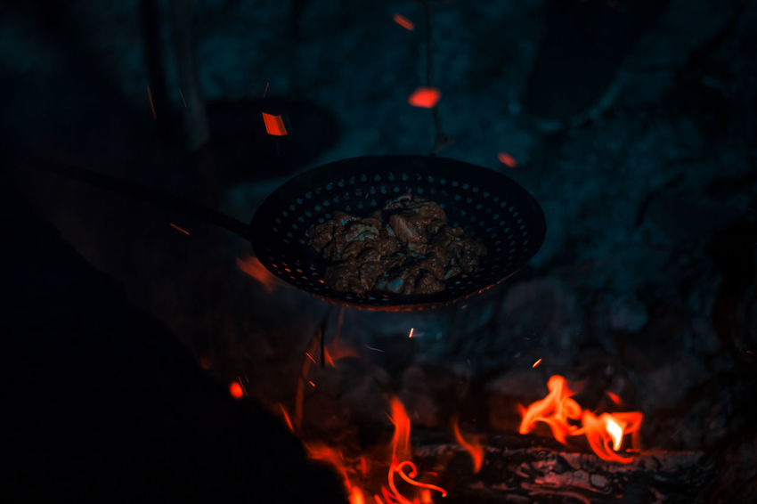 Raw and wild .. Chıcken darkness and light Shadows & Lights Travel Yercaud Nature Wild Raw Dark Night Fire Adventure Midnight Orange Meat Close-up Bonfire Fire Heat Campfire Smoke Flame Burning Fire Pit Fire - Natural Phenomenon Barbecue Grill Firewood Coal Lit Hot The Traveler - 2018 EyeEm Awards