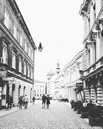 Bielsko Biała city Center City Architecture Building Exterior Large Group Of People Built Structure Sky City Life Outdoors Poland 💗 Poland Is Beautiful City Streets  Gallery Eyeem Landscape Atmospheric Perspective City Streets  Poland Eyeem Week Of Poland Walk This Way EeyemBestEdits Transportation Road Sign