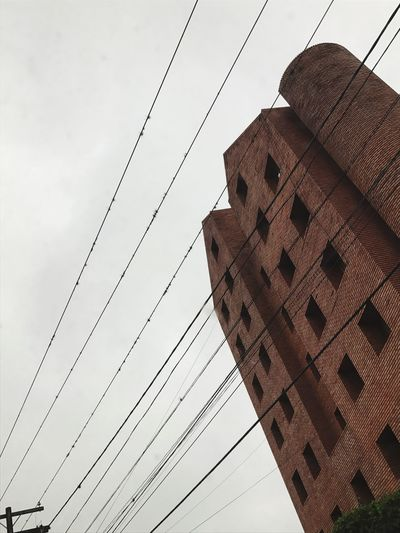 Ladrillo. Architecture Low Angle View Cable Built Structure Building Exterior Sky City Building City Street Buildings