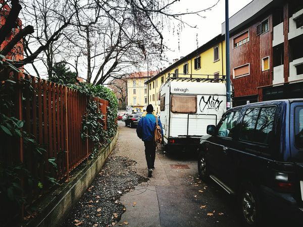 The long walk of a man. Milano Lambrate Rear View Tree Walking Transportation Building Exterior Outdoors Land Vehicle Real People City Men Day Sky Clouds
