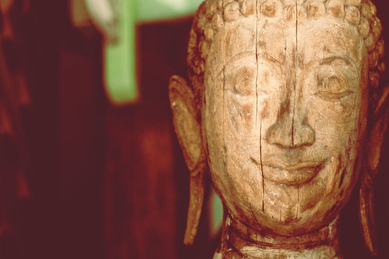 A wooden buddha head sculpture statue background Buddha Buddha Statue Buddha Temple Buddha Head Buddha Sculpture Wood - Material Art And Craft Sculpture Religion Ancient Civilization Carving - Craft Product Focus On Foreground Close-up Craft Spirituality History Carving