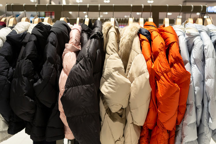 Winter coats hanging for sale on rack in store