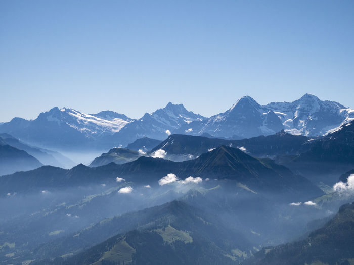 Morning fog over Eiger, Mönch and Jungfrau Morning Morning Sky Niesen Switzerland Alps Alps Alps Switzerland Beauty In Nature Blue Clear Sky Eiger Moench Jungfrau Fog Landscape Mountain Mountain Peak Mountain Range Mountain Ridge Nature Scenics - Nature Sky Switzerland Switzerlandpictures Tranquil Scene Tranquility The Great Outdoors - 2018 EyeEm Awards