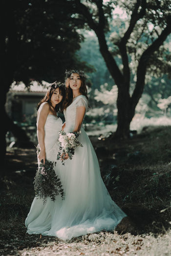 Adult Adults Only Beautiful People Beauty Bride Day Evening Gown Formalwear Full Length Nature Only Women Outdoors People Togetherness Tree Two People Wedding Wedding Dress Women Young Adult