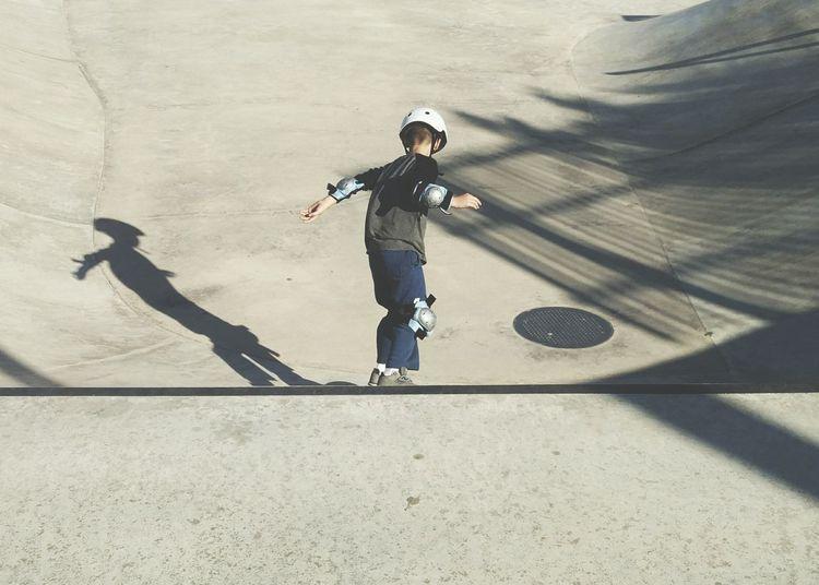 High Angle View Of Boy At Skateboard Park