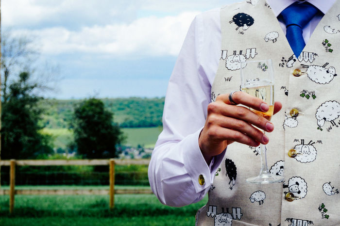 Champagne Cheers Close-up Countryside Day English Countryside Event Farm Fence Glass Grass Groom Human Hand Leisure Activity Marriage  Nature One Person Outdoors Real People Scenics Sheep Sky Tie Tree Wedding Place Of Heart
