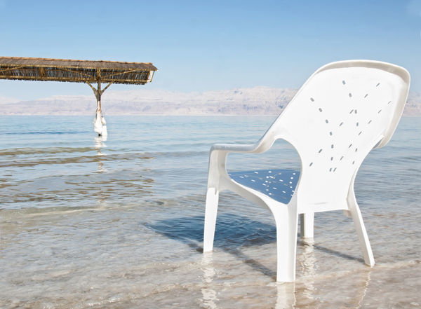chari at dead sea Beach Beauty In Nature Blue Chair Day Dead Horizon Over Water Nature No People Outdoors S Scenics Sea Water