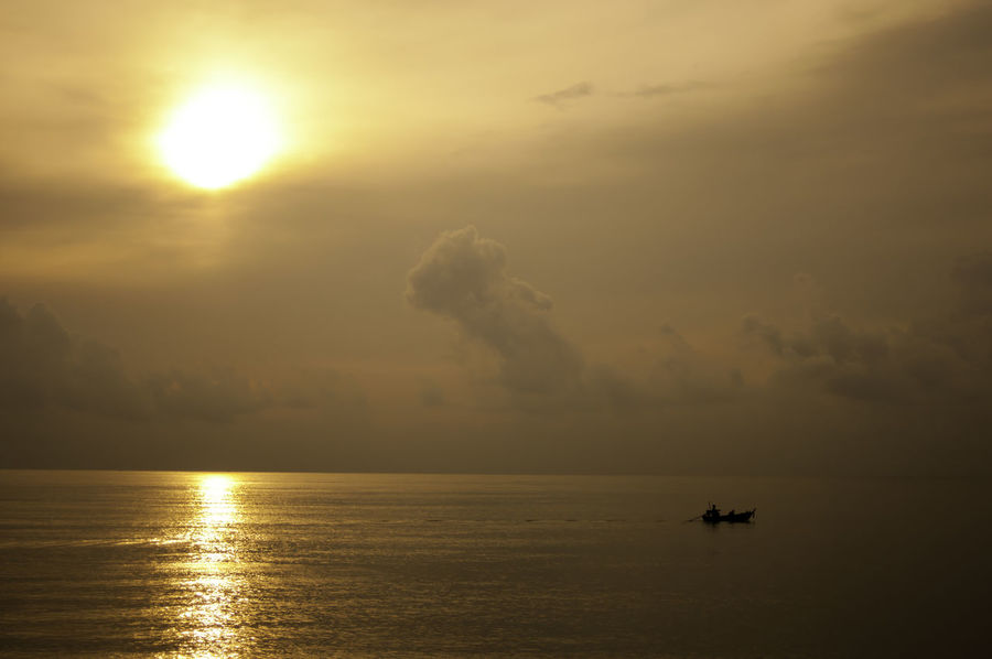 lonely boat in the golden light Beauty In Nature Cloud - Sky Day Fisherman Boat Goldenlight Homeward Bound Horizon Over Water Lonely Boat Nature Nautical Vessel Ocean Outdoors Reflection Sailing Scenics Sea Silhouette Sky Sun Sunset Tranquility Transportation Twilight Sky Water Waterfront