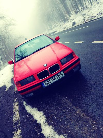 A snowy day Car Bmw Old Snow Winter Red Shades Of Winter